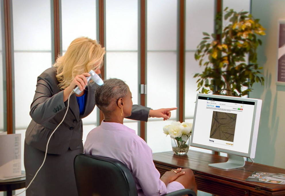Hair Club Consultant Using Trichoview Device to Assess Hair Loss