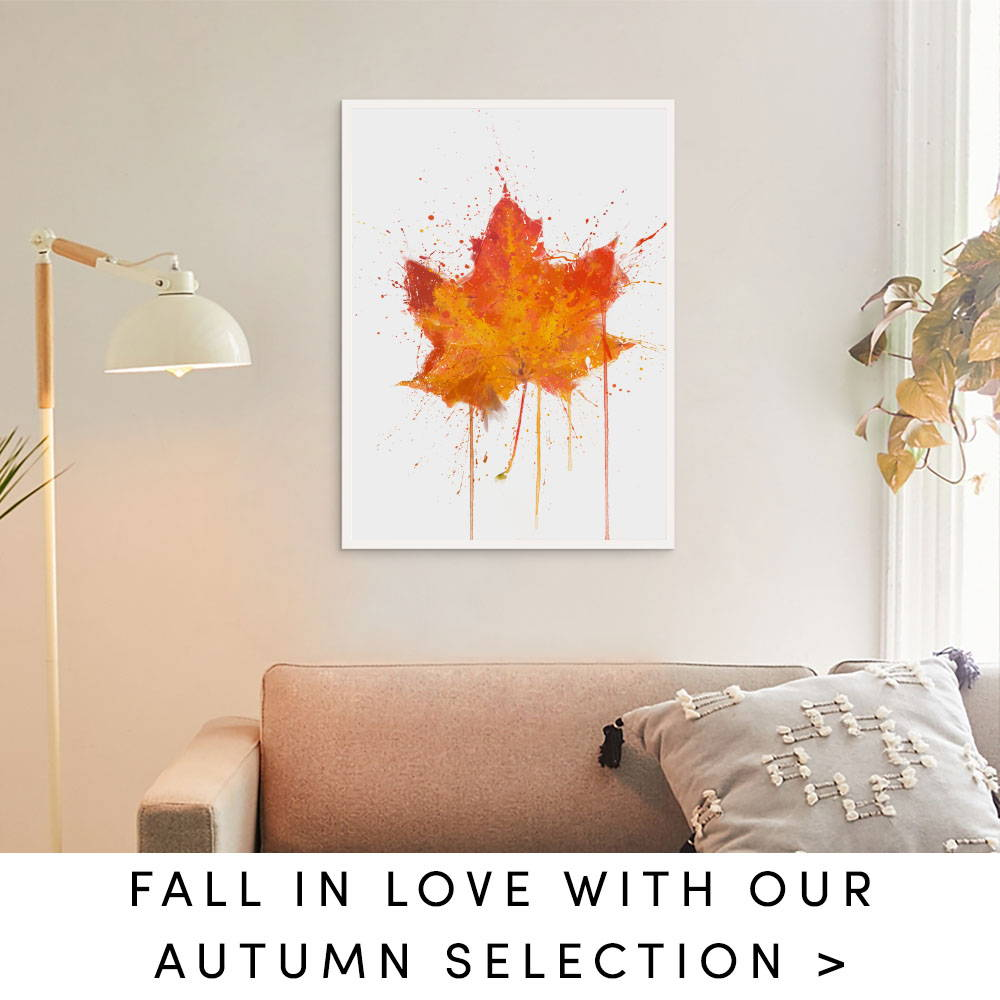 Maple leaf splatter art wall print in an autumn living room