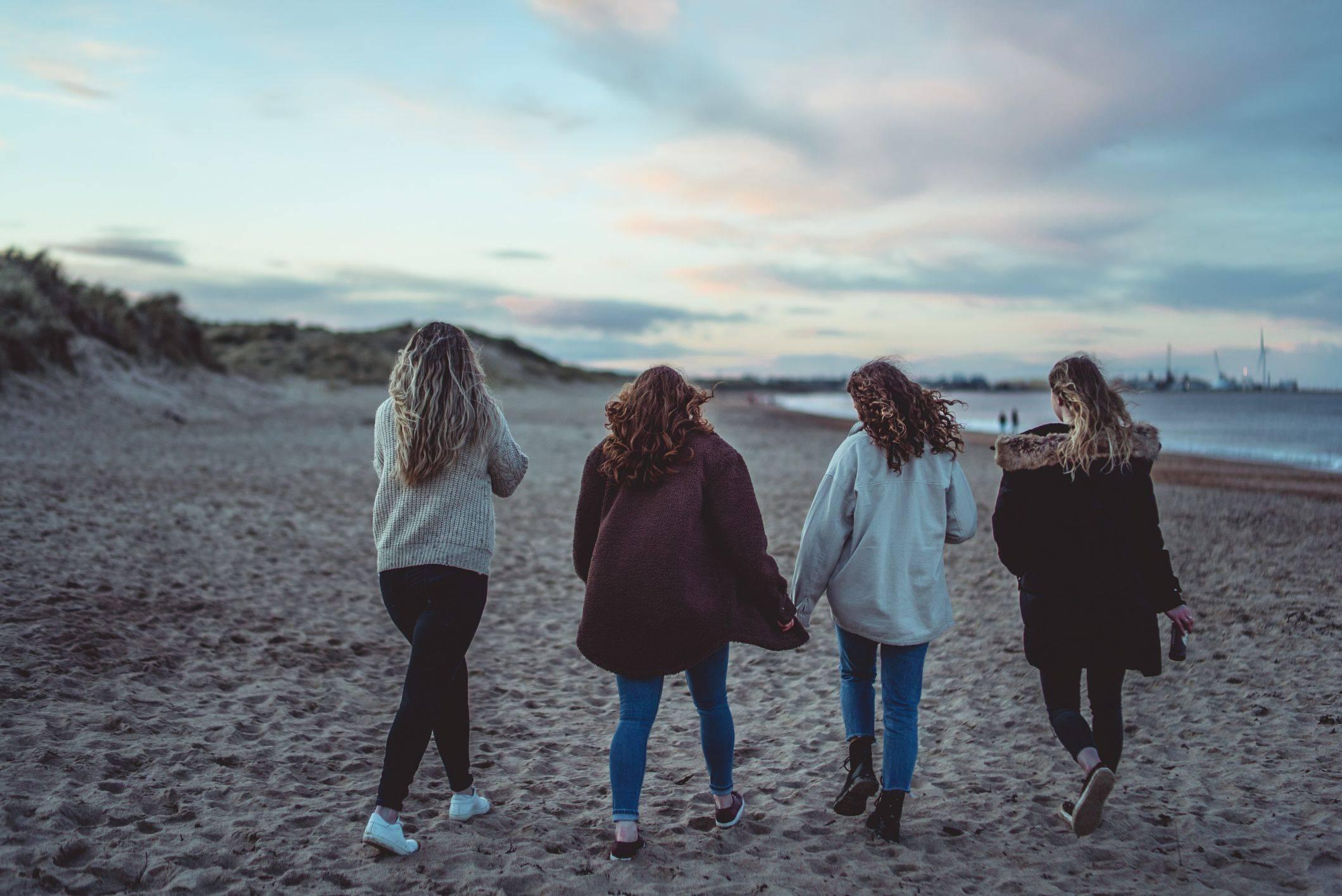 Image of girls walking on beach