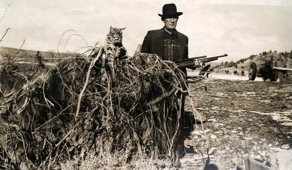 The Reverend Daniel Call, seen here with a wild cat in the late 1800′s, taught Jack Daniels the art of distilling and sold him his first still.