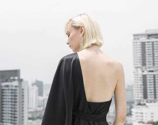 a woman wears a black dress