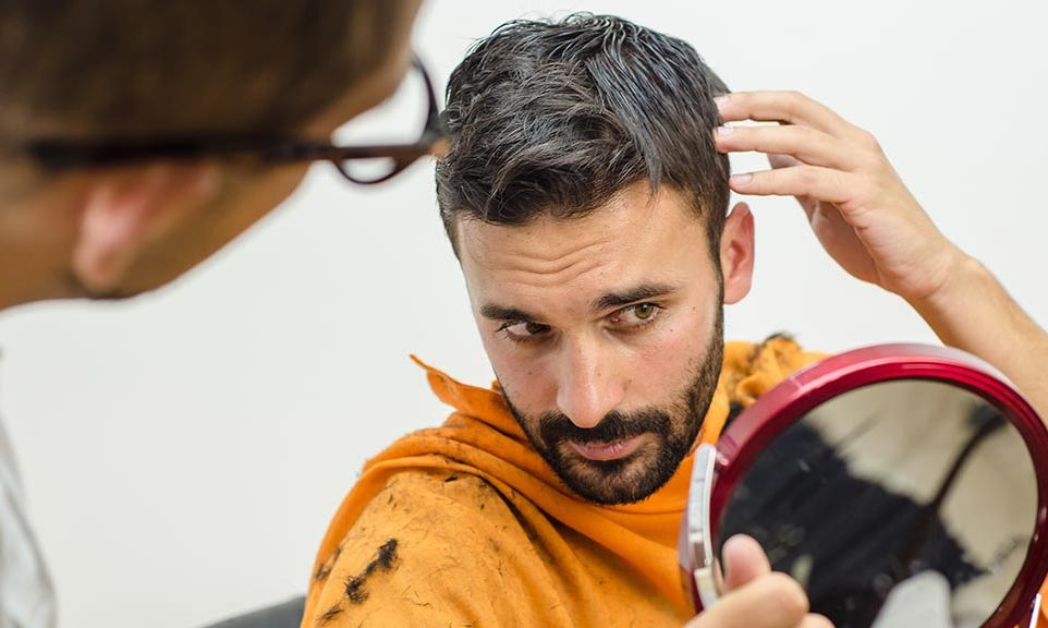 man checking on thinning hair
