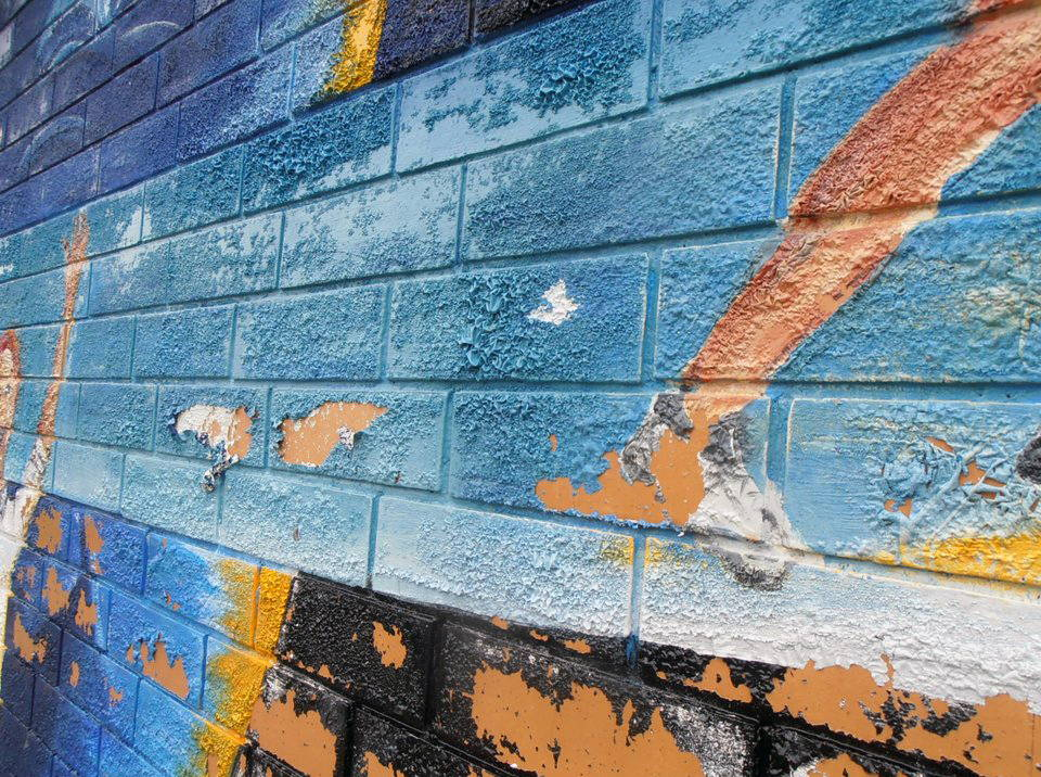 removing paint from a mural