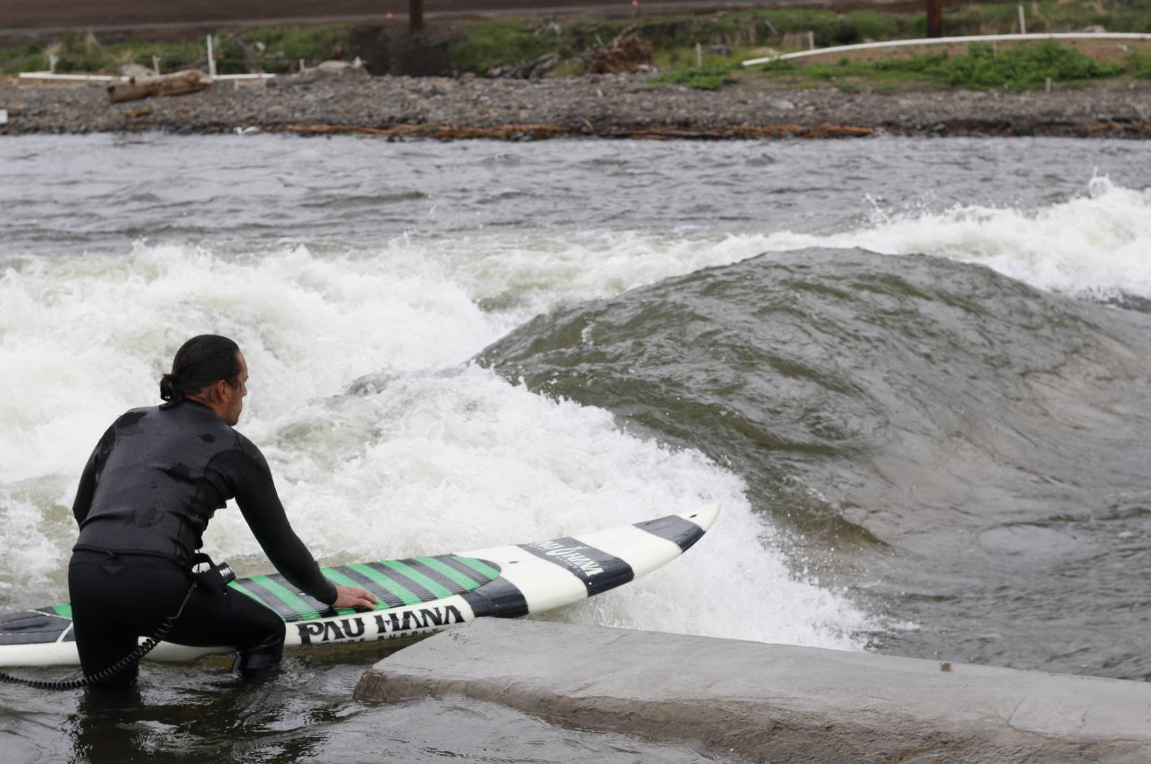 Todd about to launch his surfboard on the bend Oregon river wave