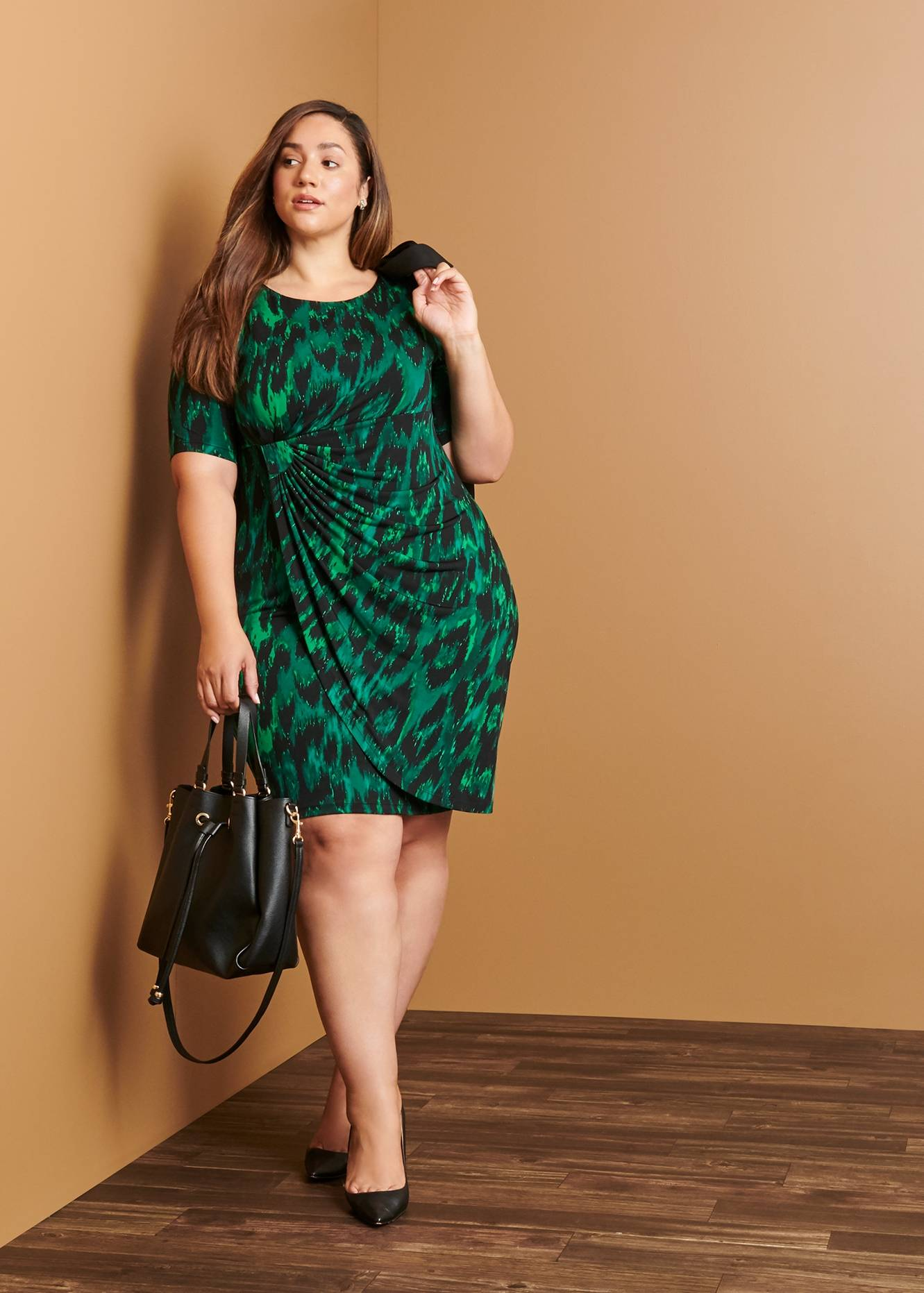 plus size woman in green animal print work dress on connected apparel day to night blog