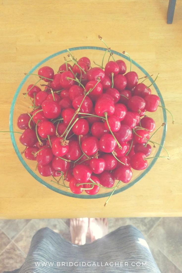 Cherry-Studded French Yogurt Cake recipe - photo of a bowl full of pie cherries \\ full recipe on www.bridgidgallagher.com