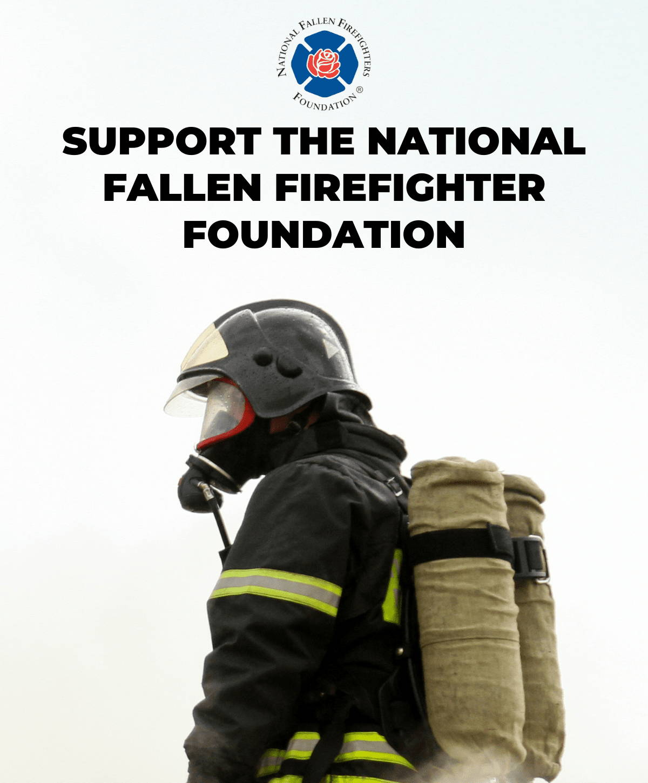 Firefighter fighting a fire in uniform