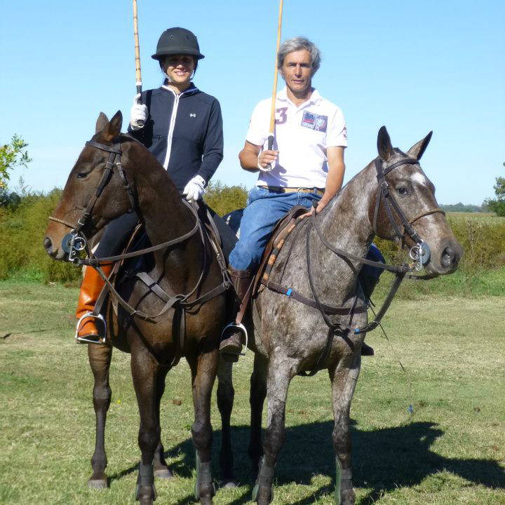 Elizabeth and dear friend sitting atop horses while playing polo.