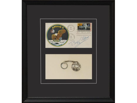 FIRST DAY COVER WITH APOLLO 11 KEY RING SIGNED BY BUZZ ALDRIN.