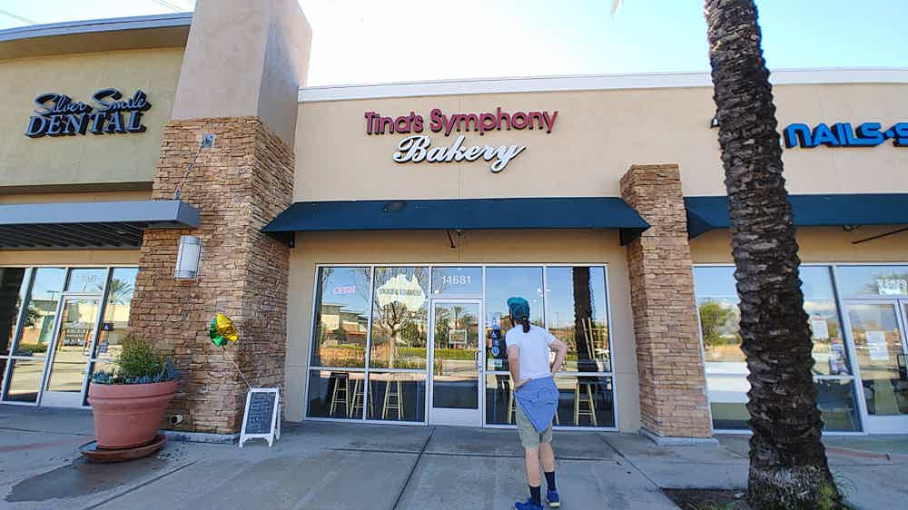 Man standing in front of Tina's Symphony bakery in Chino Hills