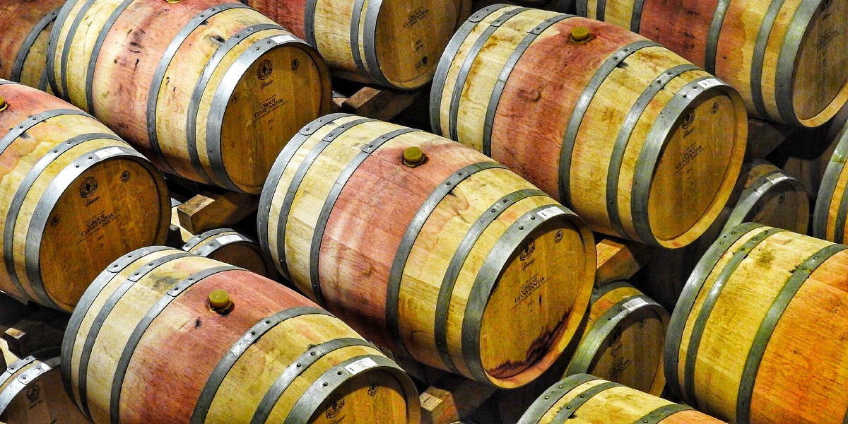Wine barrel uncovering the recent shift in winemaking techniques from non-vegan to vegan-friendly winemaking.
