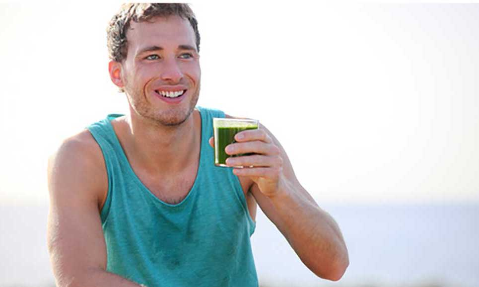 man holding a healthy shake