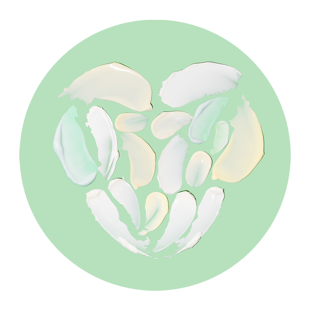 Image of cream goops forming a heart on a mint green background