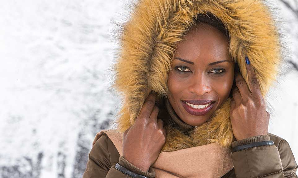 woman wearing a fur coat with hood