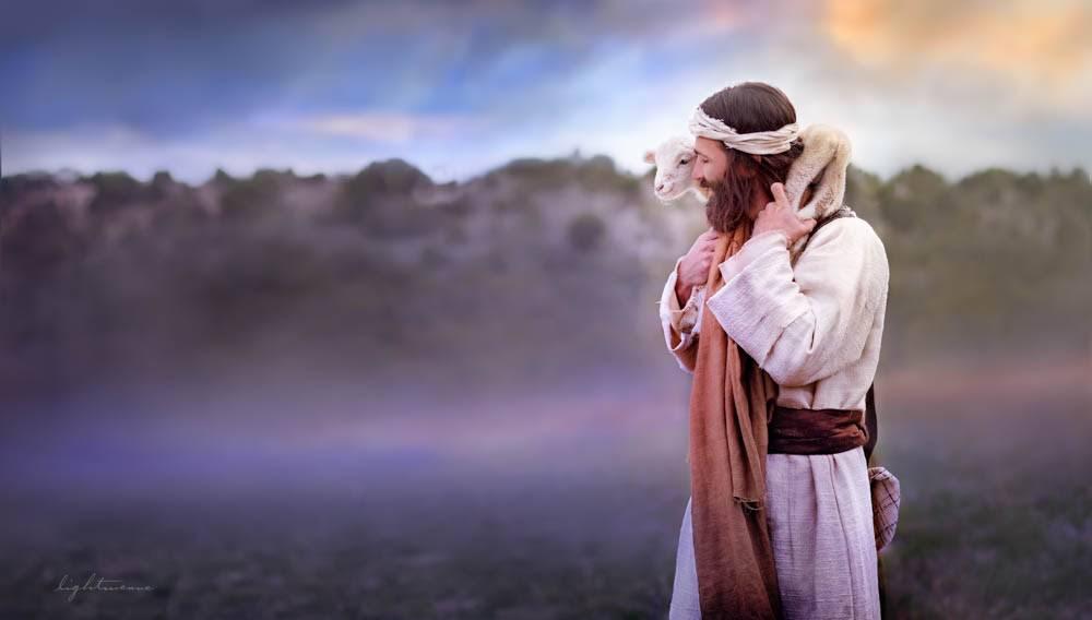 Image of Jesus good shepherd carrying  a lamb on His shoulders.