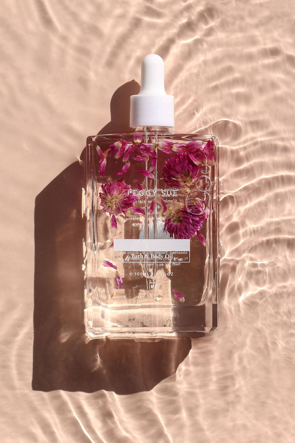 Product shot of Pink Body + Bath Oil