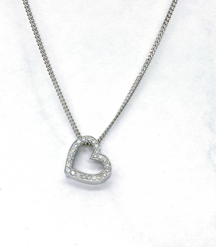 Chain with a heart-shaped white gold pendant with diamond pavement