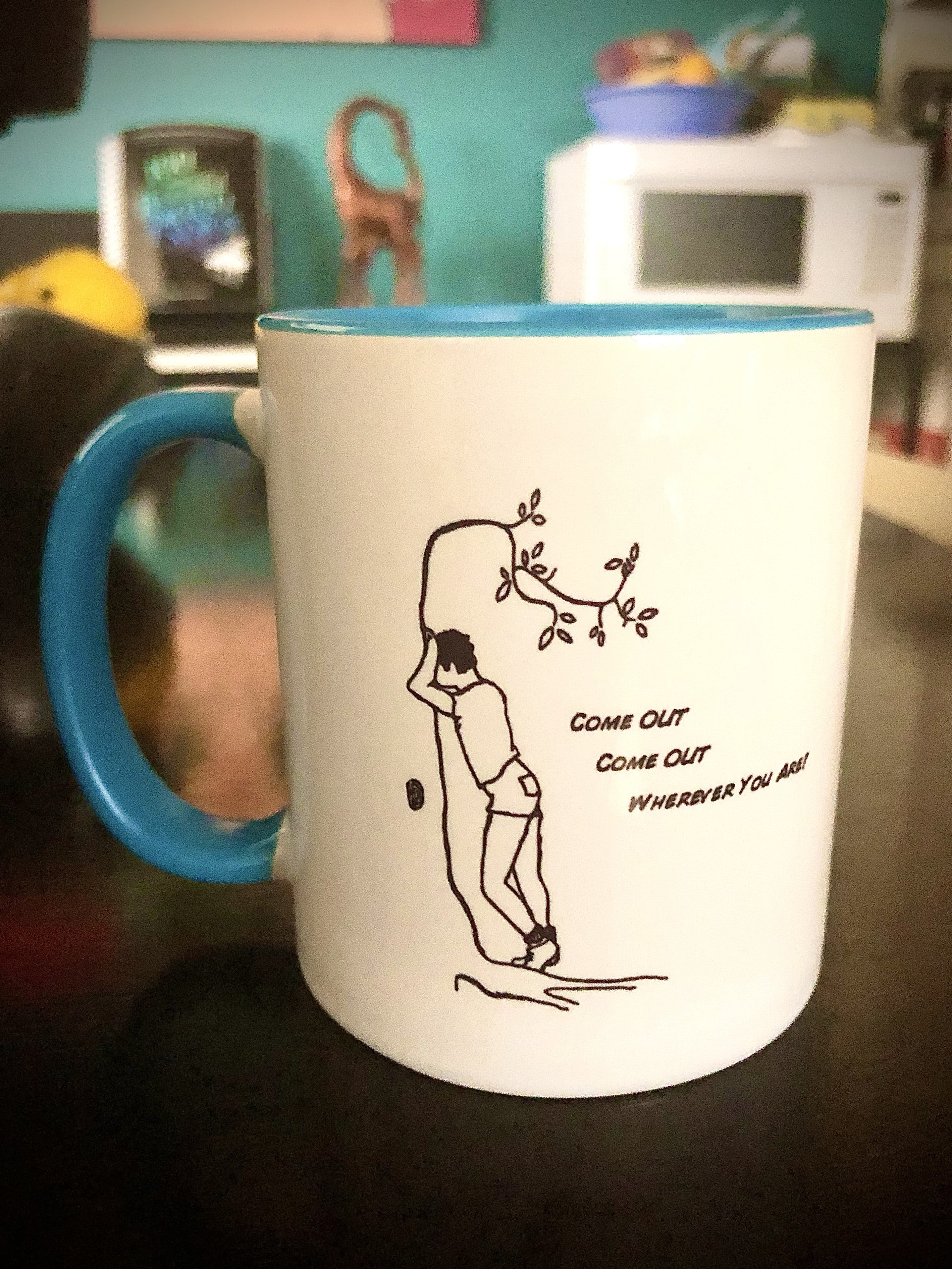A mug with a man and the text
