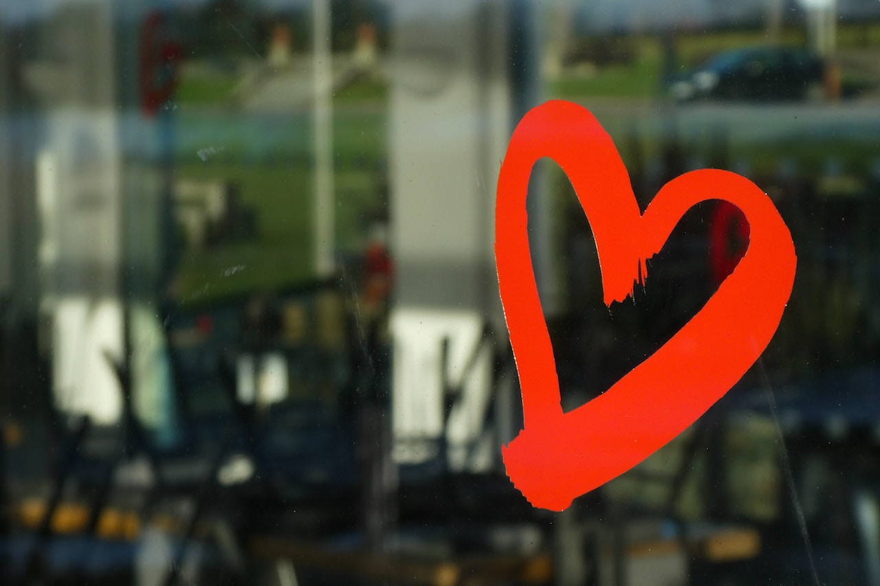 red heart drawing on glass window - Lily Gardner London