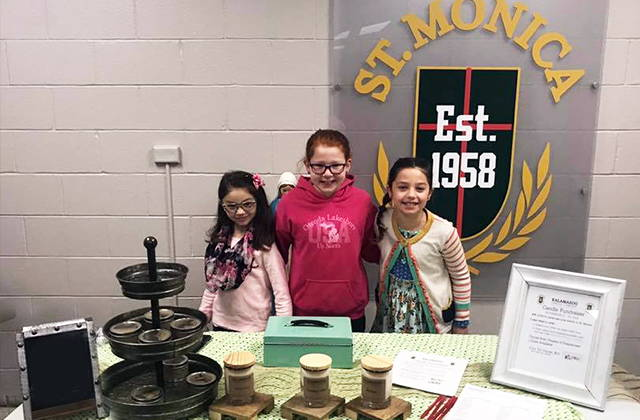 St. Monica's students selling candles for their fundraiser