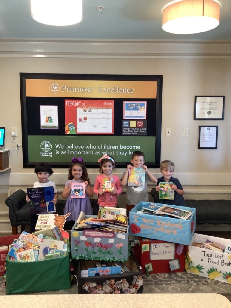 Primrose students posing with donated books