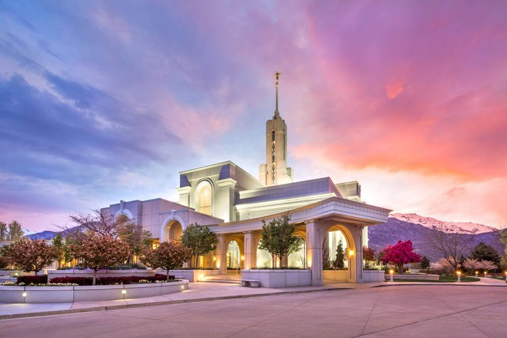 LDS art photo of the Mt Timpanogos Temple in front of a blue and pink sky.