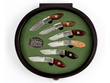 Black Round Display with Six Knives
