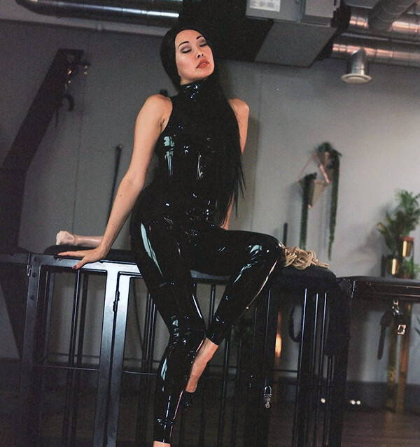 Female Wearing Vex Latex Outfit
