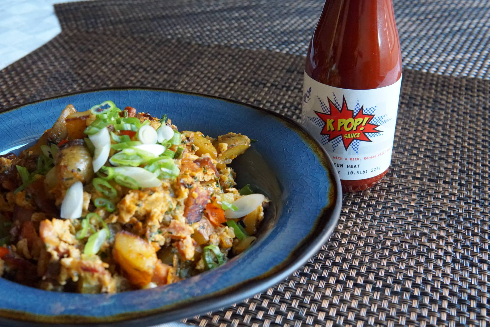 Breakfast skillet with potatoes and kpop sauce