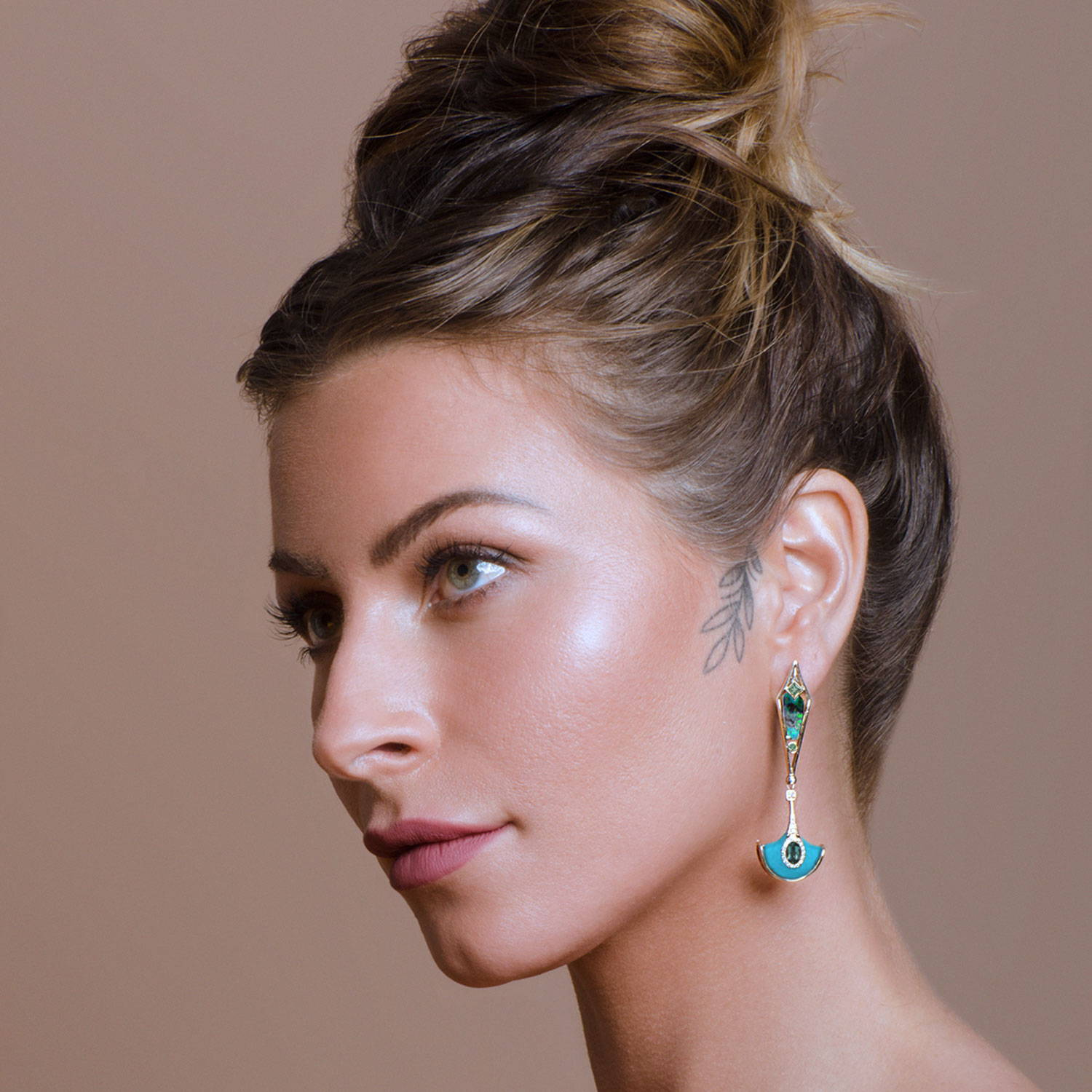 Model wearing Blue and Turquoise Statement earrings with the Gemstone Boulder Opal, diamonds and sage-coloured tourmaline. By K8 Jewelry Concepts Bijoux made in Montreal.
