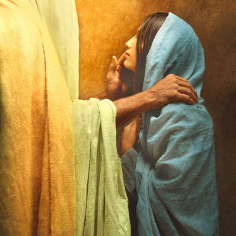 Jesus placing His hand on a young woman's shoulder to comfort her.