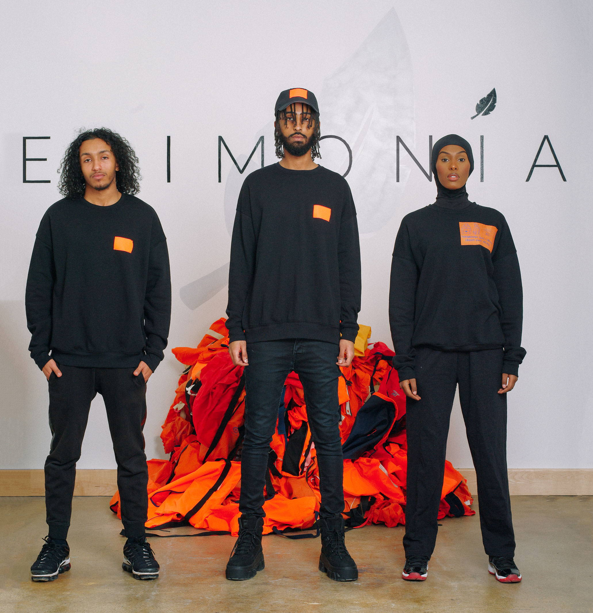 Refugee Models Wearing Epimonia Life Jacket Sweatshirts and Hats
