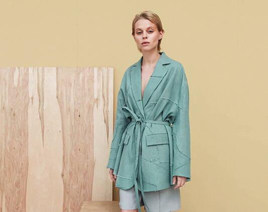a woman wears a green jacket