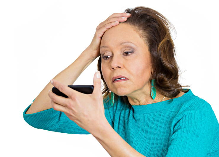 woman looking concerned about hair loss