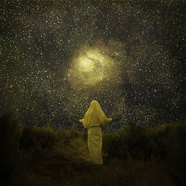 LDS art painting of Jesus Christ peering at the starry sky and Earth's creation.