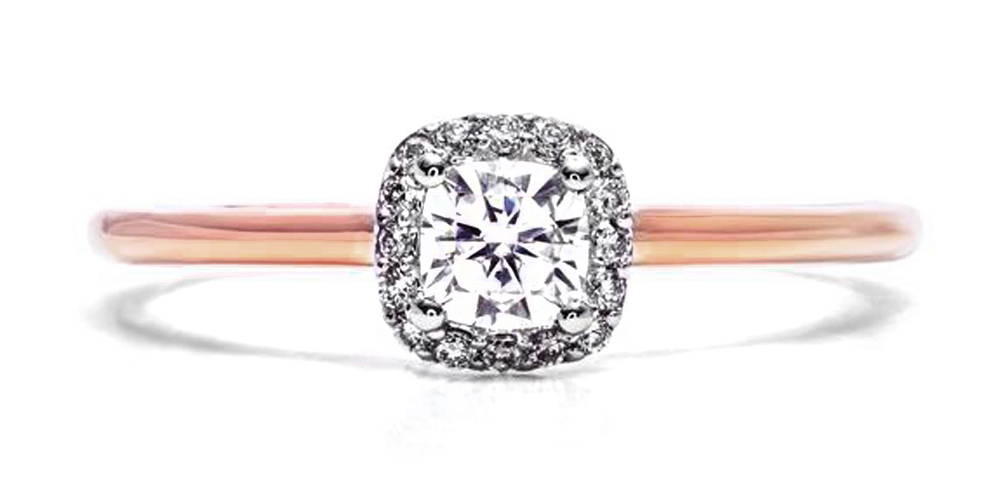 A solitaire curved by 16 natural diamonds or with a 30 point cushion cut stone in the center.