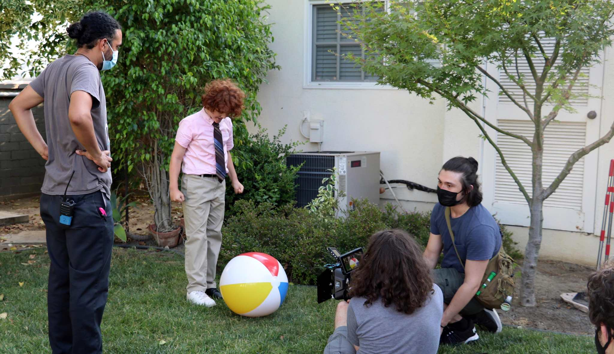 Mason C. Wells, who plays Odom the IRS neighbor's son, prepares to stomp on the twins beachball.