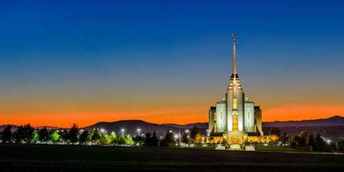 Rexburg Temple picture of an orange sunset against a deep blue sky.