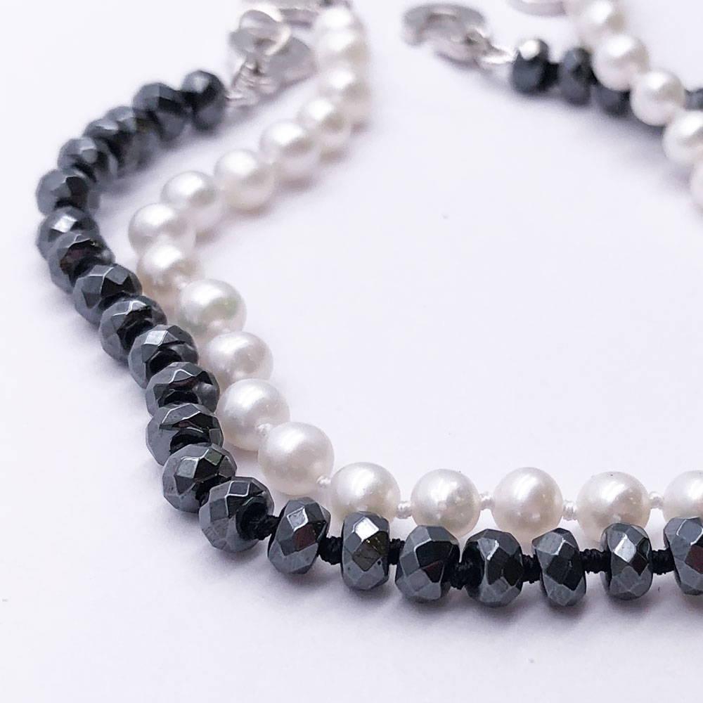 stringing black and white beads