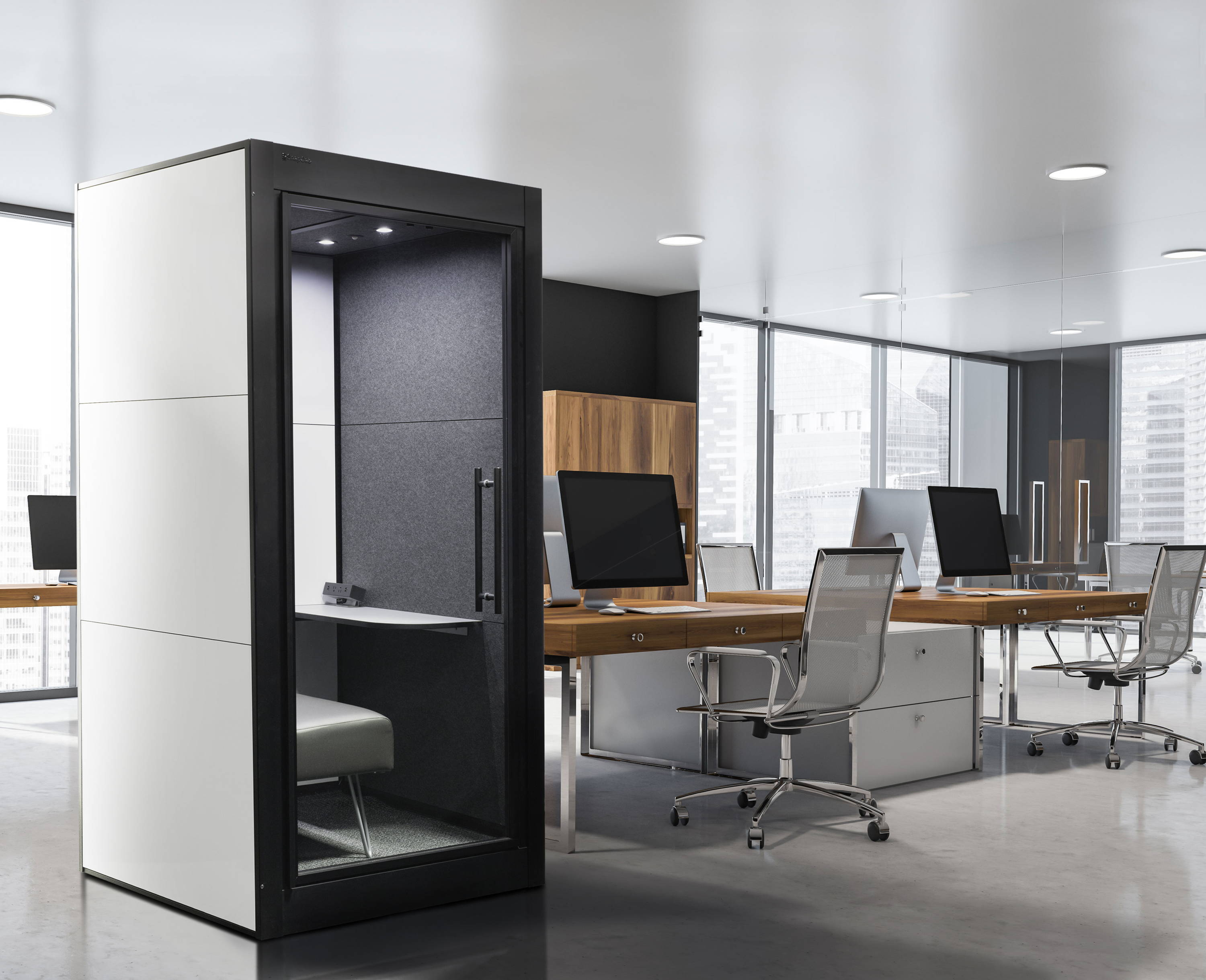 SnapCab Focus Office Pod in open office environment designed with black frame