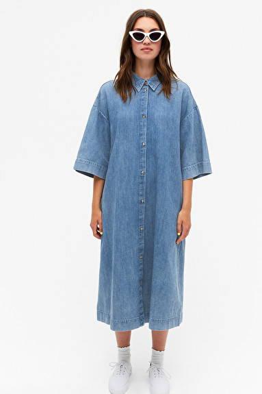 Woman wearing blue indigo organic cotton shirt dress