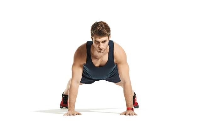 Get into a pushup position with your legs spread wide for support.
