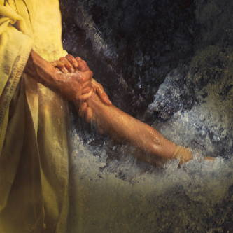 Up-close image of Jesus gripping Peter's arm as He pulls Peter from the sea.
