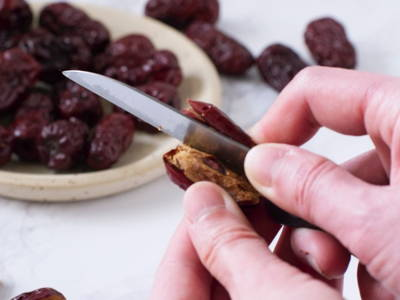 Remove seeds of red dates before adding to soups/dishes or steep them in hot water and drink as a tea. Dried red dates can also be eaten as it is.
