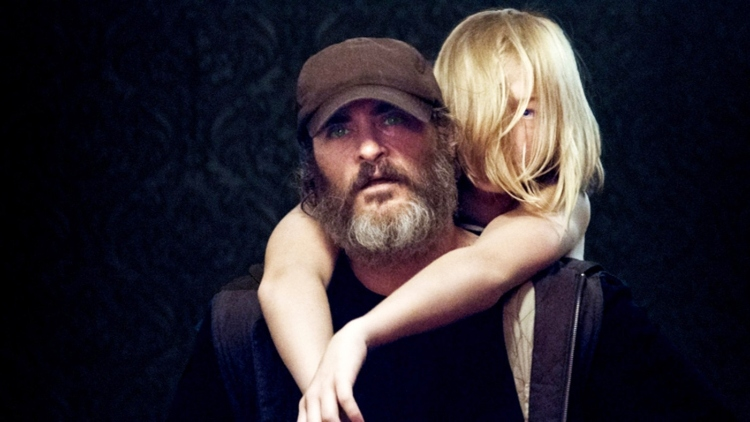 Bearded man carrying a blonde-haired girl on his back
