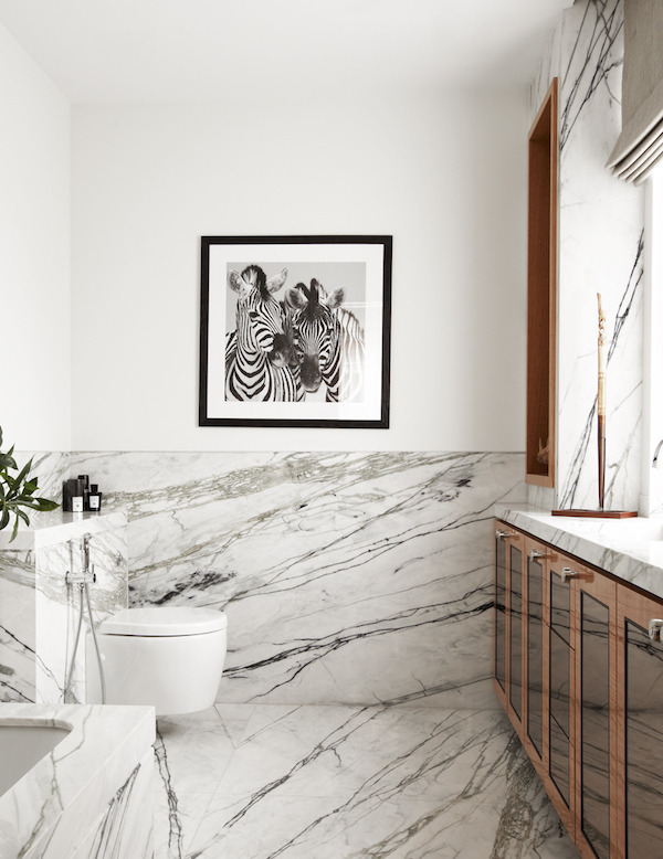 Modern bathroom with marble floor sand walls