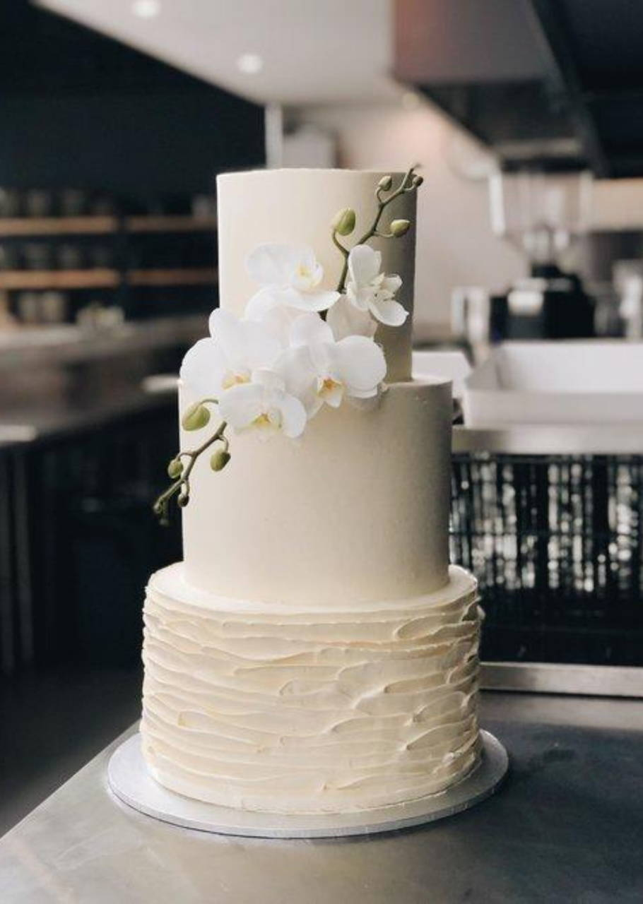 Three Tier Minimal Ruffle and Smooth Buttercream Finish with Orchids