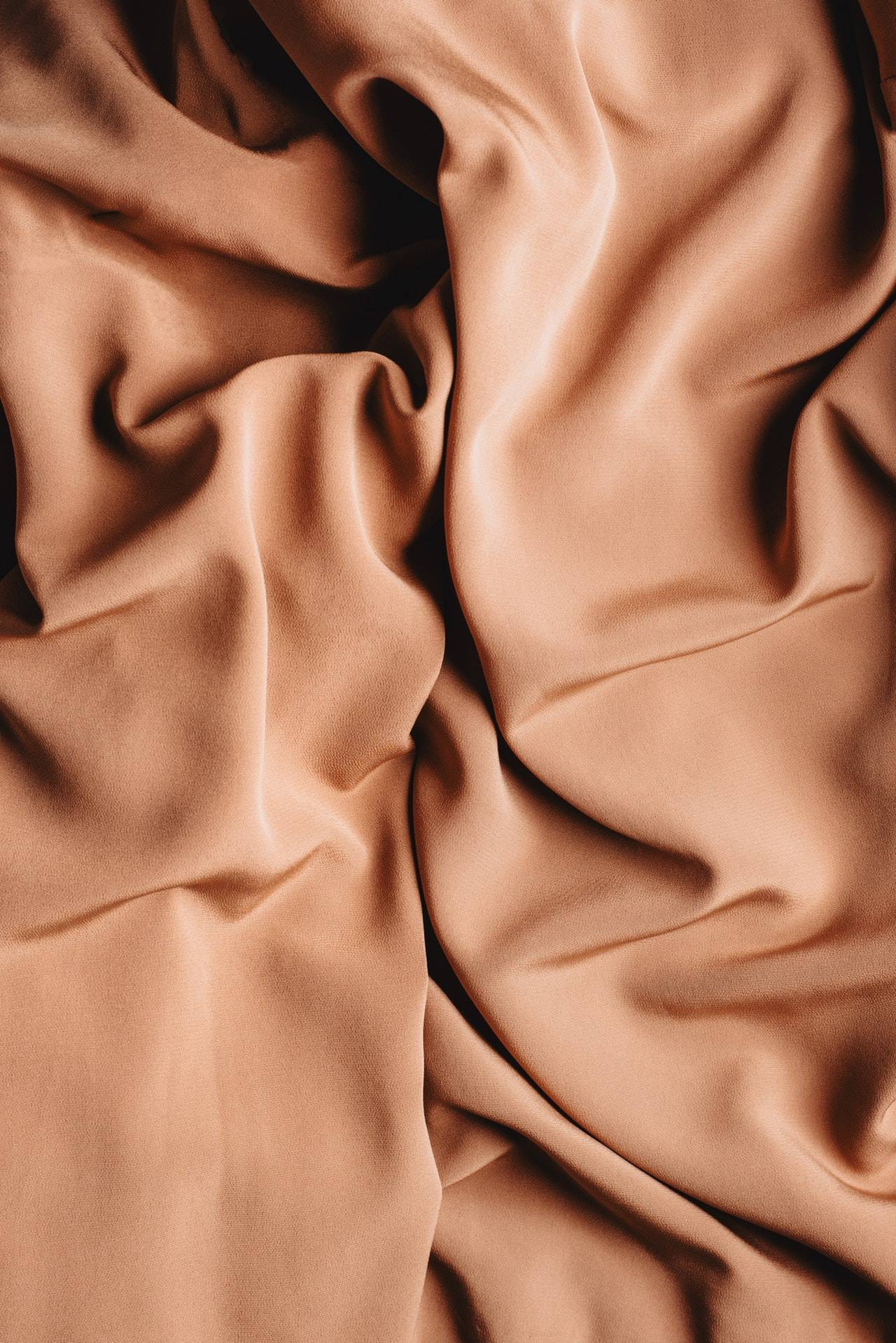 Textured backdrop of crumpled textile with a smooth surface
