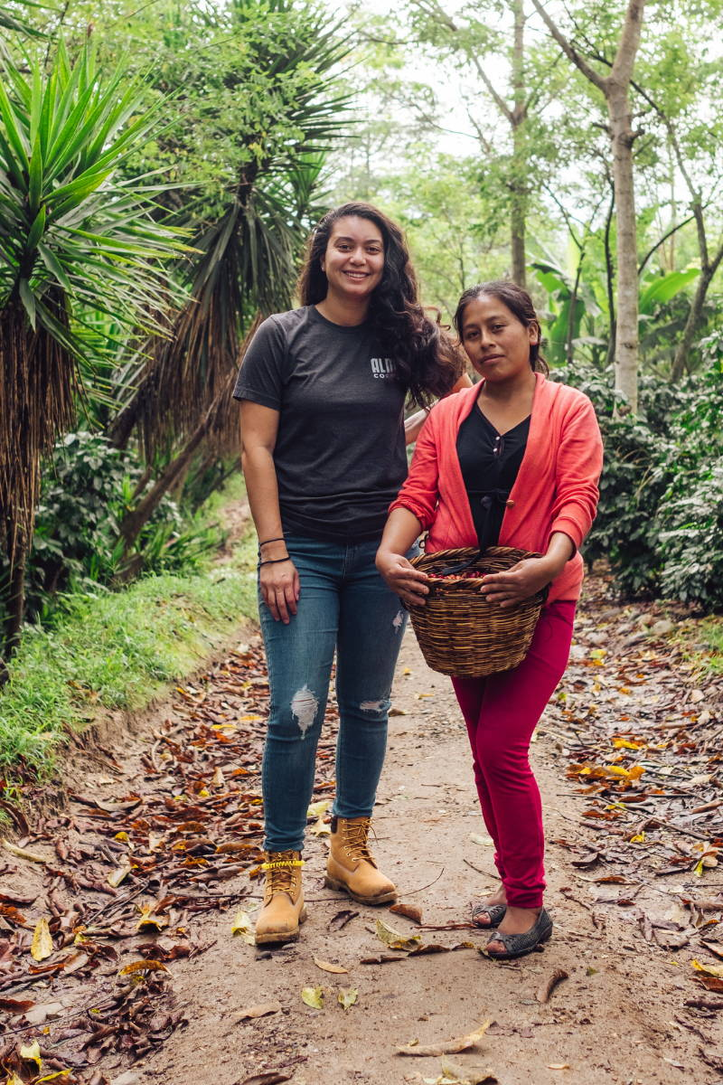 Woman Coffee Picker with Owner of Alma Coffee.