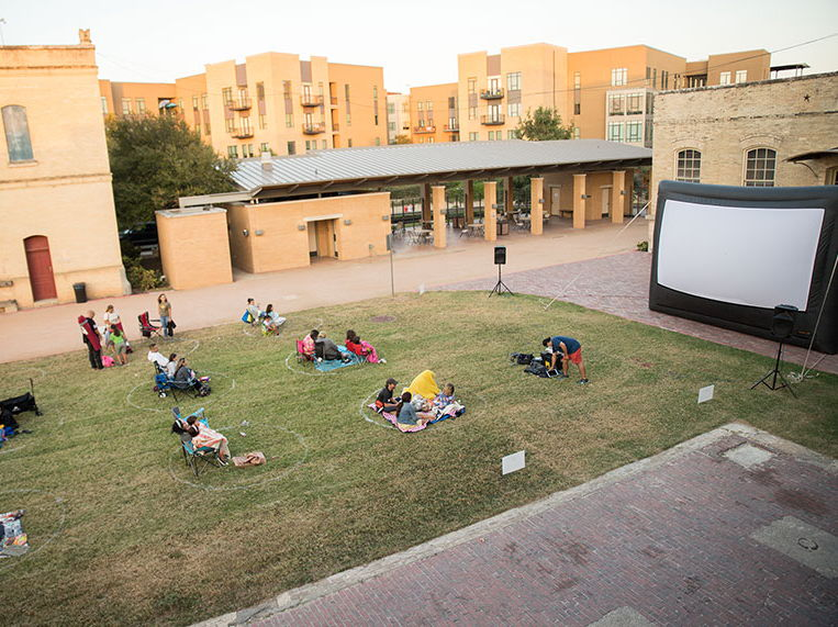 Guests viewing a movie on the west courtyard